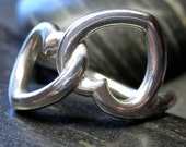 Intertwined heart knot ring in Sterling silver