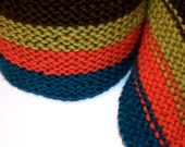 The Pelican Fly Knitted Skinny Scarf in Brown, Lime, Coral and Navy