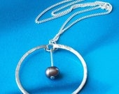Sterling Silver Big Circle Pendant with Black Pearl in Center, hammered and textured, classic design