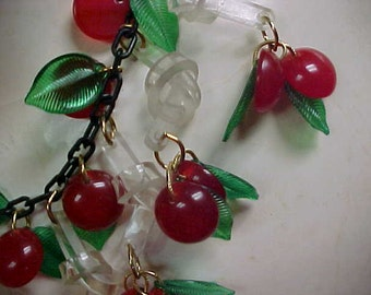 Jan Carlin Bakelite Cherry Necklace Jan Carlin Original design clear Lucite dangling Knots with red bakelite Cherries