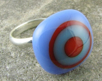 Adjustable Glass Ring - Periwinkle and Orange Bullseye Design. Handcrafted and designed glass jewelry.