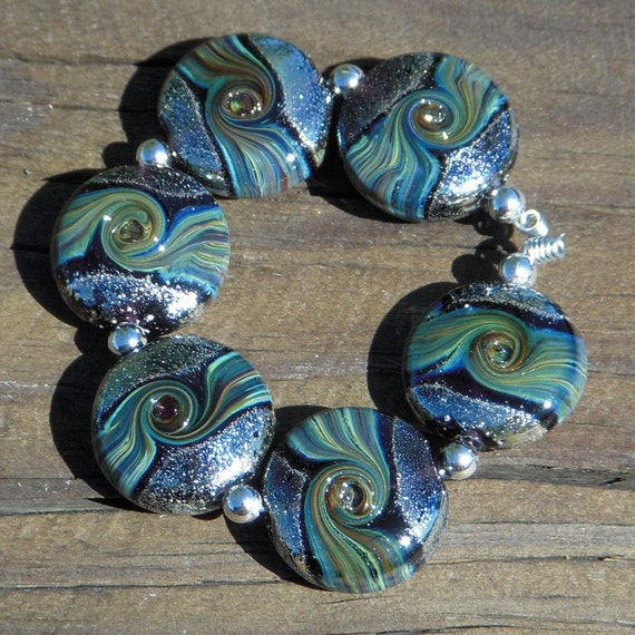 Handmade lampwork beads...Magnetism