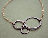Three Silver Circles and Gold-Filled Chain