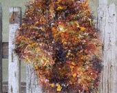Sale item - Comet - Reindeer-inspired, upcycled black and autumn-toned knit scarf with jingle bells