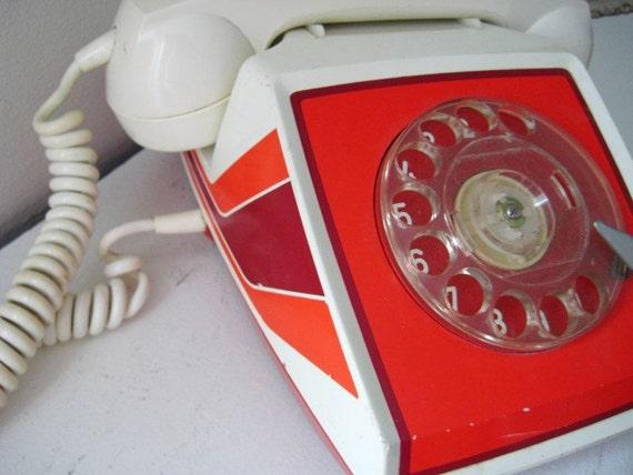 Retro ITT rotary phone with 3 orange stripes