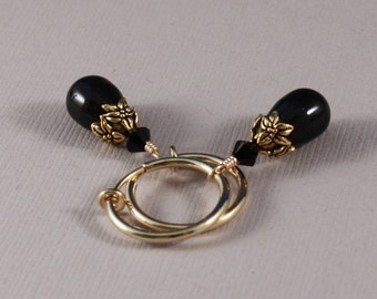 Clip on hoop earrings with Mystic Black pearls and Antique Gold bead caps