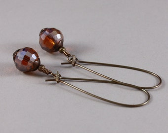 Vintaj natural brass elongated kidney wires and Dark Topaz AB