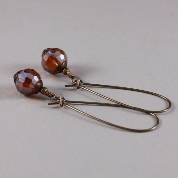 Vintaj natural brass elongated kidney wires and Dark Topaz AB