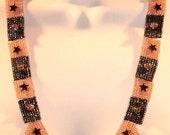 Hematite stars and peach sparkle necklace