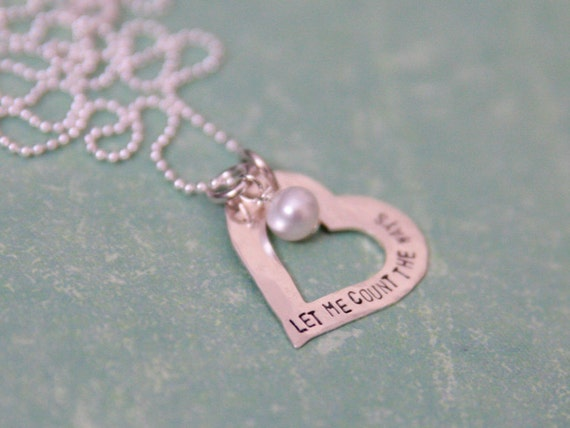 rustic heart necklace topped with a pearl.