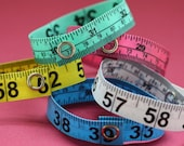 Five Pack of Tape Measure Bracelets in Various Colors
