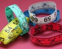 Five Pack of Tape Measure Bracelets in Various Colors