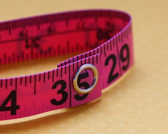 Tape Measure Bracelet in Pink- Statement Jewelry created with Upcycled Measuring Tape - Vinyl Snap Bracelet - Crafty Repurposed Trashion