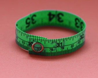 Tape Measure Bracelet in Green - Statement Jewelry created with Upcycled Measuring Tape - Vinyl Snap Bracelet - Crafty Repurposed Trashion