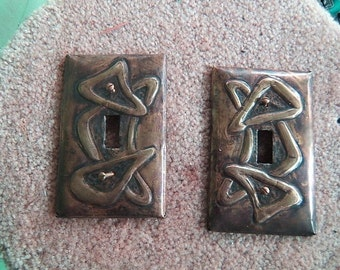 Pair of Brass Abstract Switchplates