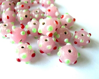 10 BEADS ,lampwork glass bead, pink with  green and red dots, might be vintage