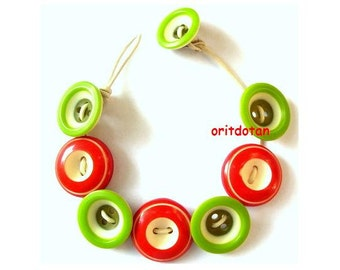 Jewelry made of vintage buttons, red green white colors on leather cord