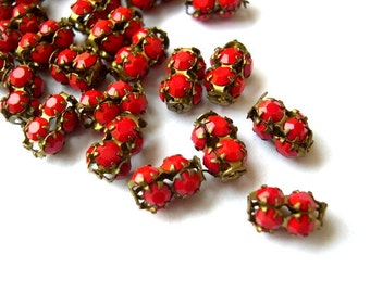 2 SWAROVSKI  beads, antique vintage, opaque redcrystals in metal setting