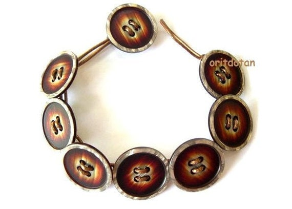 Button jewelry made of vintage buttons on leather cord