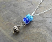 blue LAMPWORK slider necklace on sterling silver chain