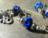 Cobalt Blue Lampwork and organic sterling charm BRACELET - XOXO - hugs and kisses
