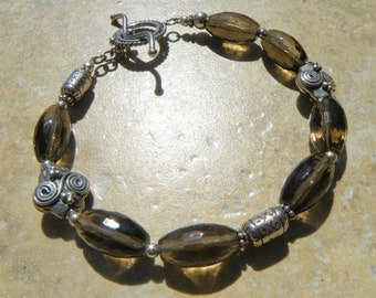 faceted Smoky Quartz barrel beads and Bali sterling silver BRACELET