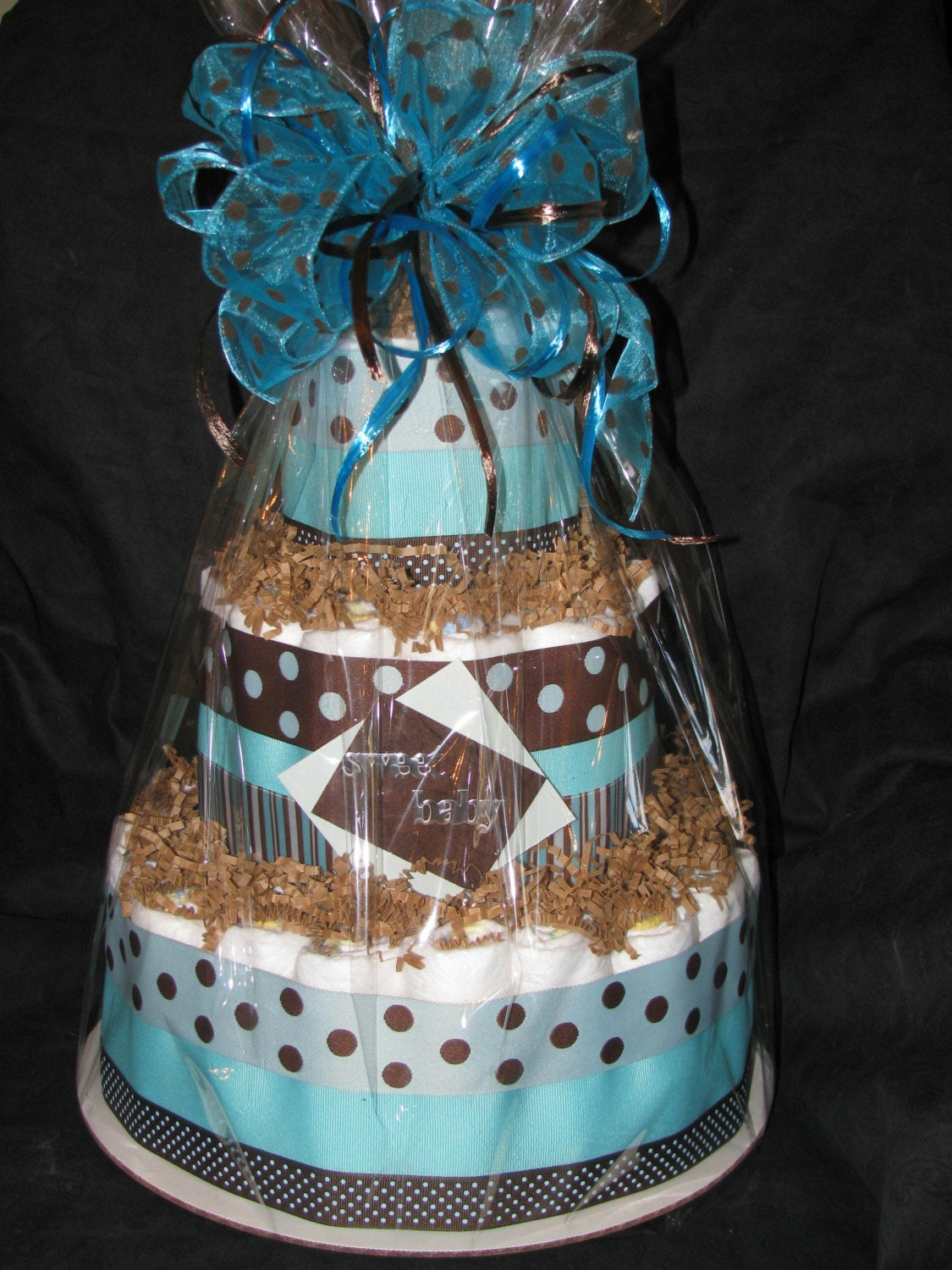 Aqua and brown boys diaper cake centerpiece by baby2bnashville