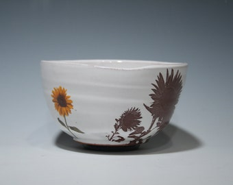 Handmade bowl with images of sunflowers and glossy white glaze