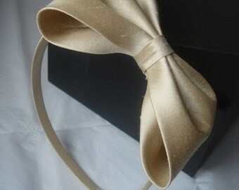 Beige dupioni silk alice band with large bow by Agnes