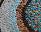 Old braided rug, deep turquoise, browns, beige