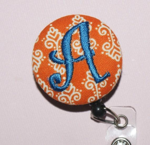Many fabrics to design YOUR Badge Reel. Monogrammed single letter, Orange damask