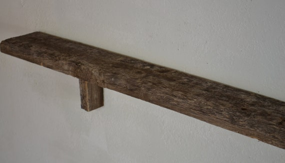 Reclaimed wood wall mounted shelf 66 inches wide 6 inches deep