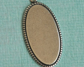 Oval Silver Charm with Beaded Detail 1911