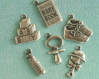 6 Silver Baby Charms 2403