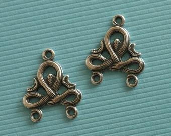 2 Silver Swirled Drop Charms 2817
