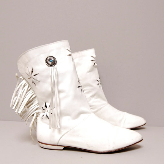 White leather boots with fringe