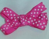 Hot pink and white polka dot bow
