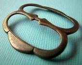 Cool steel buckle/slide in brass ox