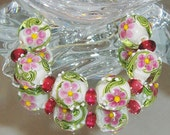 PINK SPRING FLOWERS. lampwork beads. Rounds plus spacers.
