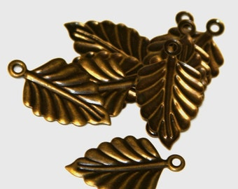 50 pcs of Antiqued brass finish leaf drops 26X15mm (NF)