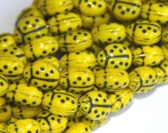 10 pcs of Yellow Lady Bug glass beads 6X8.5mm