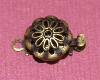 25 pcs of Antiqued Brass flower shape clasp 9mm