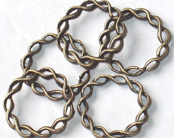 50 pcs of Antiqued brass twisted rings 20 mm