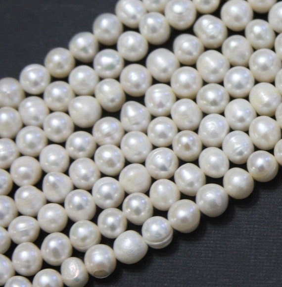 15.5 inch Strand of 6-6.5mm white potato freshwater pearls B grade
