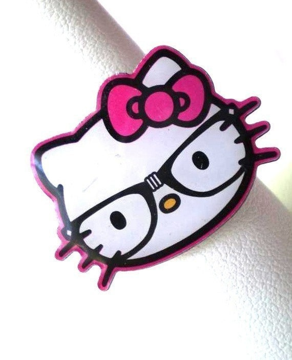 geek nerdy geeky nerd hello kitty wearing black glasses with white tape in the middle ring with pink bow