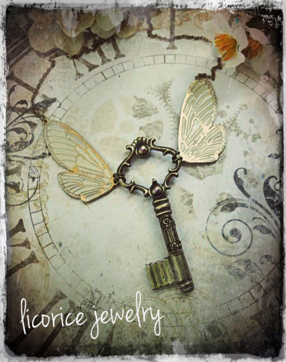 Antique Style STEAMPUNK  flying winged Skeleton Key Necklace neo victorian brass aged filigree enamel cream Swarovski crystals