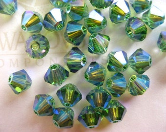 24 Erinite AB2X Swarovski Crystal Beads Bicone 5328 4mm
