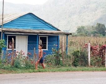 Photograph from Cuba, Blue House, Running Boy, Open Windows
