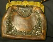 Antique, hand tooled leather handbag, bakelite handle