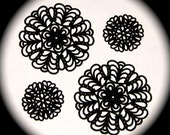 Four pieces of jet black lucite filigree rounds for making earrings, rings, pendant necklaces